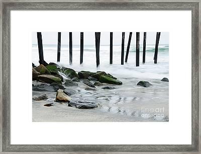 Pilings At Oceanside Framed Print