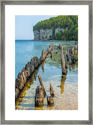 Pilings On Lake Michigan Framed Print by Paul Freidlund
