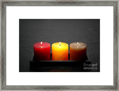 Pillar Candles Framed Print by Olivier Le Queinec