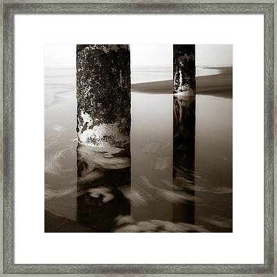Pillars And Swirls Framed Print by Dave Bowman