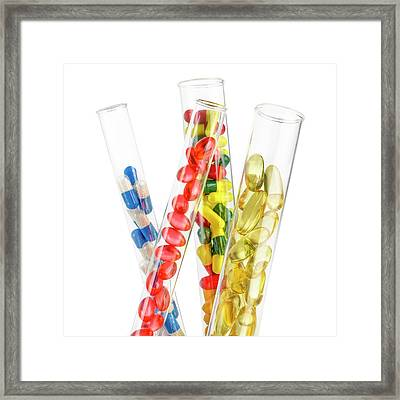 Pills And Capsules In Test Tubes Framed Print by Science Photo Library
