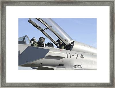 Pilots Perform Preflight Checks Framed Print by Timm Ziegenthaler