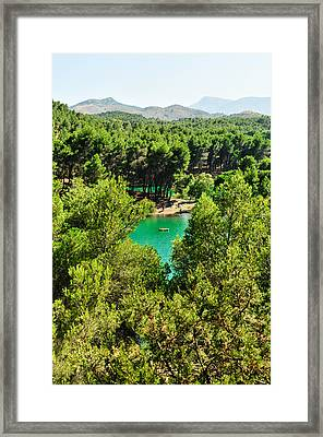 Pine Forests With Mountainous Backdrops Surround Turquoise Lakes Framed Print by Tetyana Kokhanets