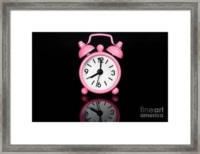 Pink Alarm Clock Framed Print by Niphon Chanthana