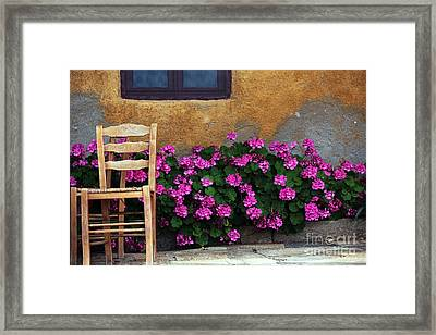 Pink And Orange In Delos Framed Print by John Rizzuto