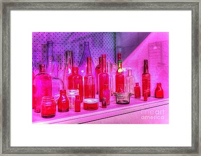 Pink And Red Bottles Framed Print by Kaye Menner