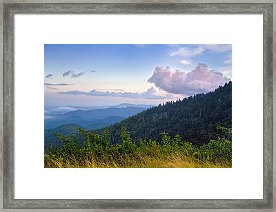 Pink Clouds On The Parkway Framed Print by Rob Travis