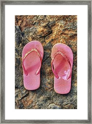 Pink Flip Flops On A Rock Framed Print