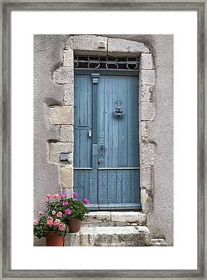 Pink Flowers And A Blue Door Framed Print