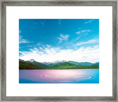 Pink Light Cast Down On Two Rings Framed Print