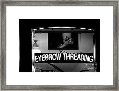 Pink Neon Eyebrow Threading Sign In Shop Window  Framed Print by Joe Fox