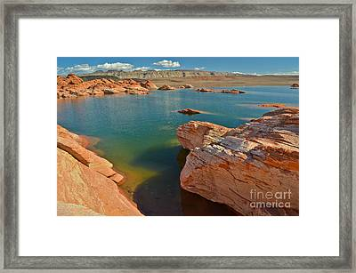 Pink Rocks Blue Water Framed Print