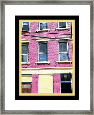 Pink Yellow Blue Building Framed Print by Kathy Barney