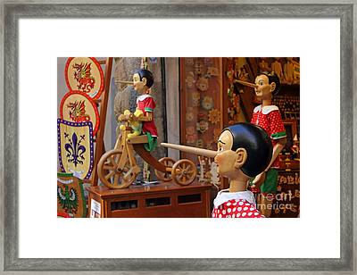 Pinocchio Inviting Tourists In Souvenirs Shop Framed Print