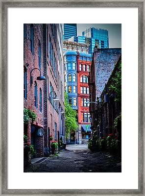 Pioneer Building Through The Alley Framed Print by Brian Xavier