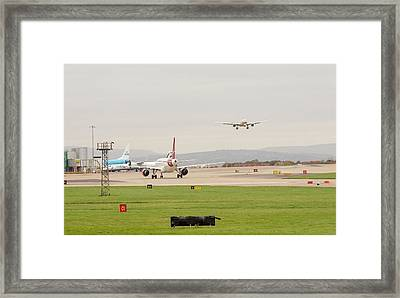 Plane Coming In To Manchester Airport Framed Print by Ashley Cooper