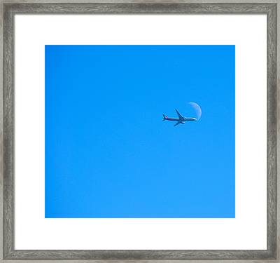 Plane Crossing The Moon Framed Print by John Rossman