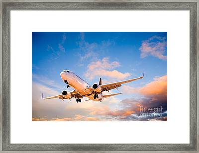 Plane Flying In Sunset Sky Framed Print by Colin and Linda McKie