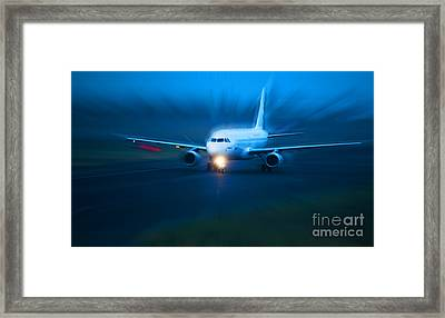 Plane Takes Of At Dusk Framed Print by Michal Bednarek
