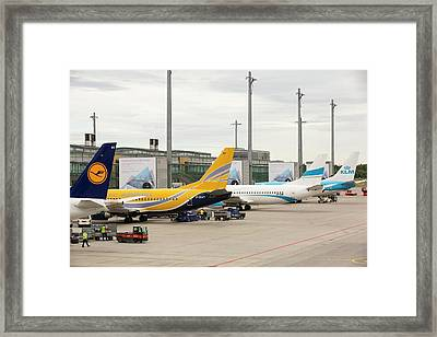 Planes On The Tarmac At Oslo Airport Framed Print by Ashley Cooper