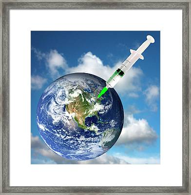 Planet Earth And A Syringe Framed Print by Victor De Schwanberg