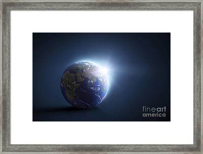 Planet Earth And Sunlight On A Dark Framed Print by Evgeny Kuklev