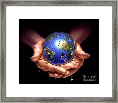 Planet Earth On Human Hands, Breaking Framed Print by Leonello Calvetti