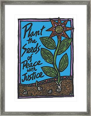 Plant The Seeds Of Peace Framed Print by Ricardo Levins Morales