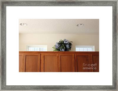 Plastic Flowers On Cabinets Framed Print by Lee Serenethos