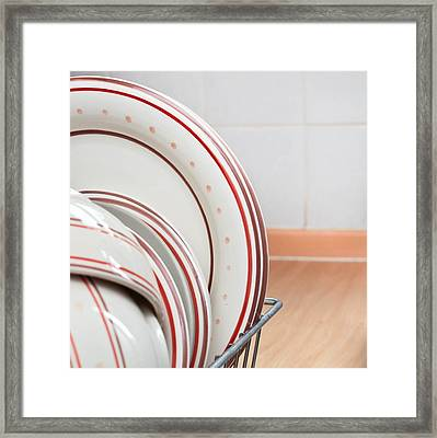 Plates Drying Framed Print by Tom Gowanlock