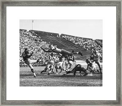 Player Blocks Football Punt Framed Print by Underwood Archives