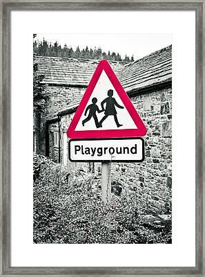 Playground Framed Print by Tom Gowanlock