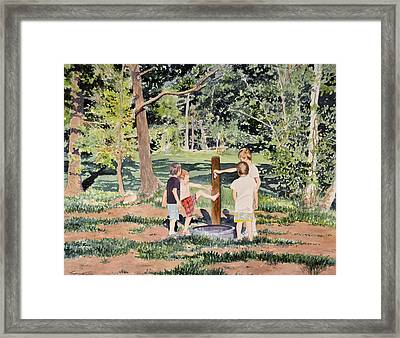 Playing At The Pump Framed Print by Thomas Stratton