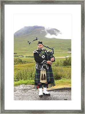 Playing Bagpiper Framed Print