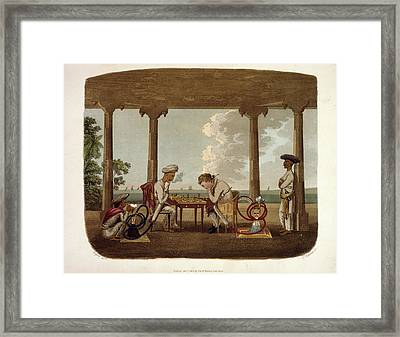 Playing Chess Framed Print