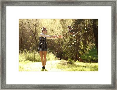 Playing Doll Framed Print by Kevin Schlanser