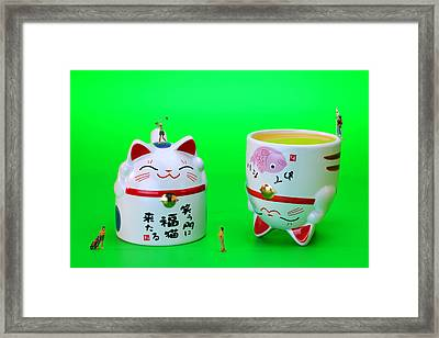 Playing Golf On Cat Cups Framed Print by Paul Ge