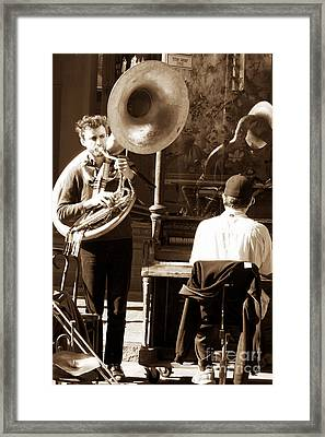 Playing In New Orleans Framed Print by John Rizzuto
