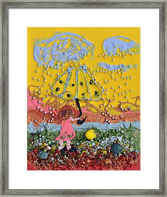 Playing In The Rain Framed Print