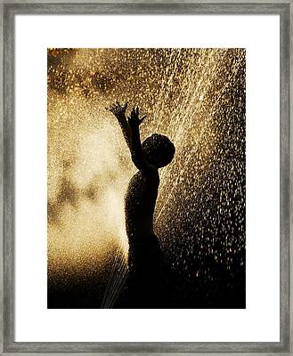 Playing In The Sprinkler Framed Print by Con Tanasiuk