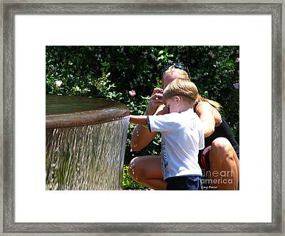 Playing In Water Framed Print by Greg Patzer