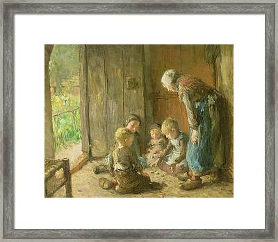 Playing Jacks On The Doorstep Framed Print by Bernardus Johannes Blommers