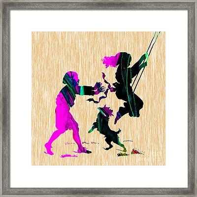 Playing On A Swing Framed Print by Marvin Blaine