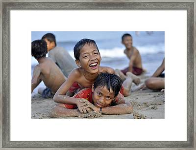 Playing On The Beach Framed Print by Achmad Bachtiar