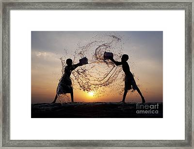 Playing With Water Framed Print by Tim Gainey