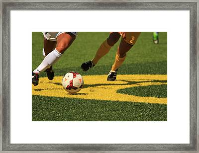 Plays On The Ball Framed Print by Laddie Halupa