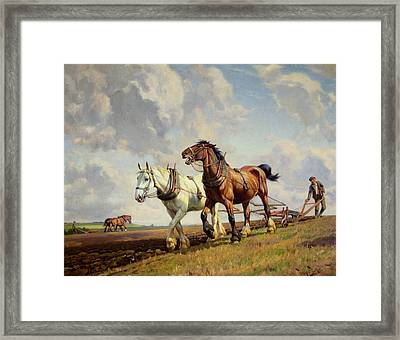 Plowing The Field Framed Print by Wright Barker