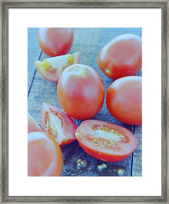 Plum Tomatoes On A Wooden Board Framed Print by Romulo Yanes