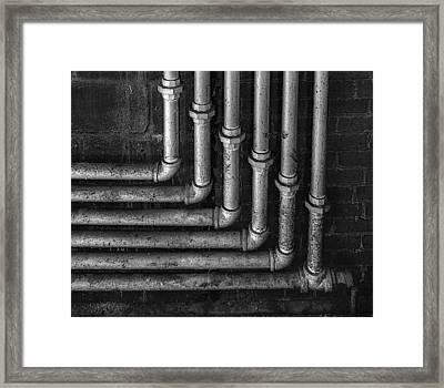 Plumbing Symmetry II Framed Print by Susan Candelario
