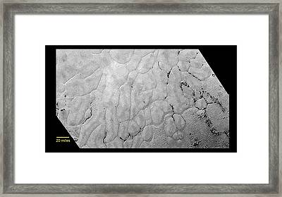 Pluto's Surface Framed Print